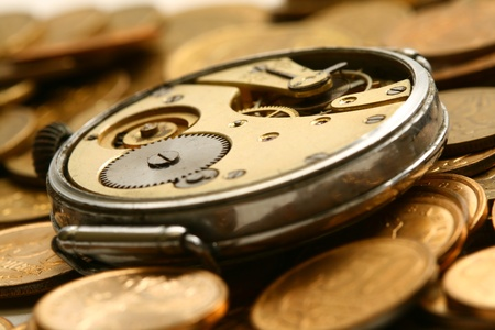 time is money coins and clock macro concet photo