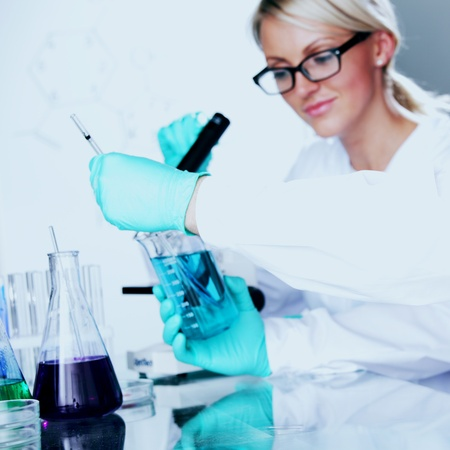two scientist in chemical lab conducting experiments Stock Photo - 10633231
