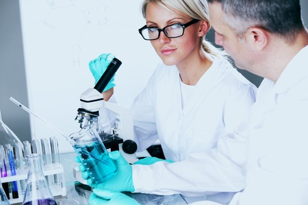 two scientist in chemical lab conducting experiments Stock Photo - 10633117