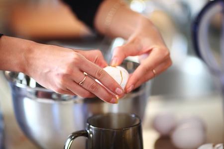 beaten woman: break an egg by cup