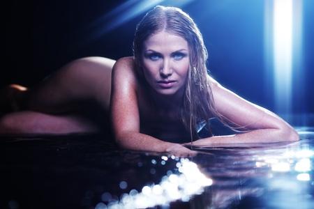 nude woman portrait in water sudio