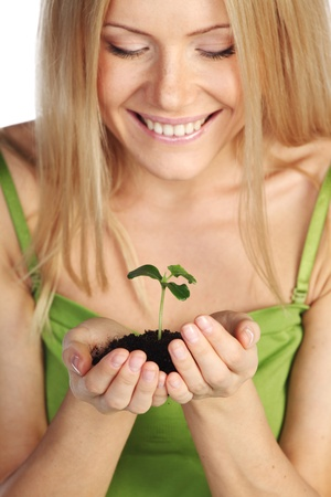plant in blonde hands close up Stock Photo - 10633126