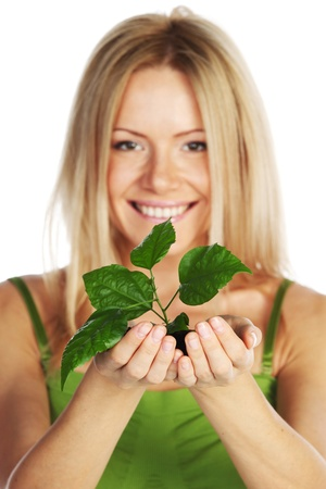 plant in blonde hands close up Stock Photo - 10633200