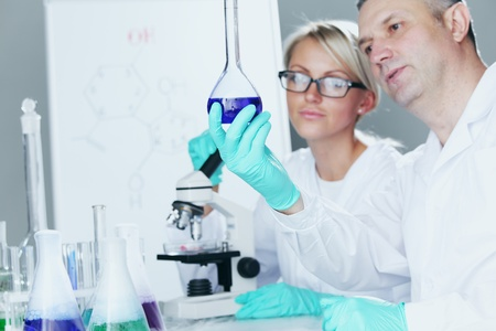 Chemistry Scientist conducting experiments in laboratory Stock Photo - 10633081