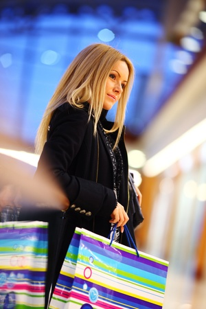 woman in shop center holds the bag in hands photo