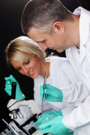 white glove test: scientists in chemical lab conducting experiments