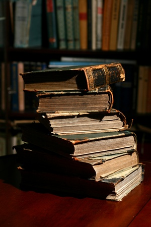 books on table in dark library room Stock Photo - 10651535