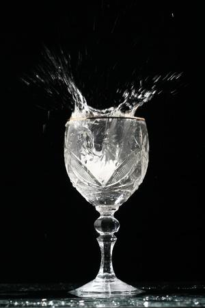 alcohol splash on black  background Stock Photo - 10669878
