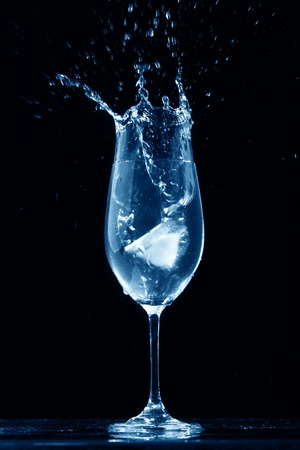 shaken: alcohol splash on black  background