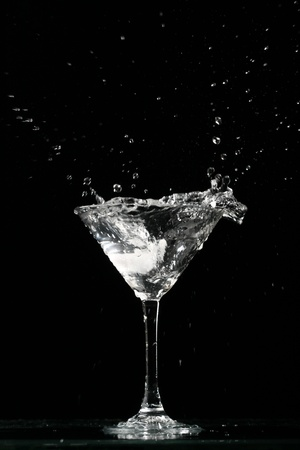 alcohol splash on black  background photo