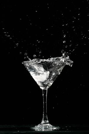 martini splash: alcohol splash on black  background