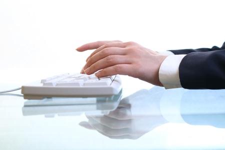 hand key: hands work on keyboard white background Stock Photo