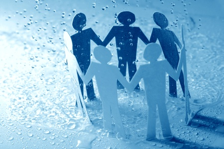paper team linked together under rain weather concept Stock Photo - 10669421