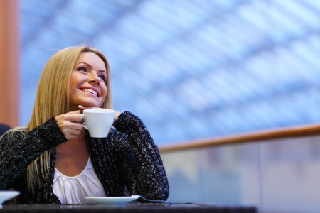 young woman drink coffee on modern background Stock Photo - 10705753