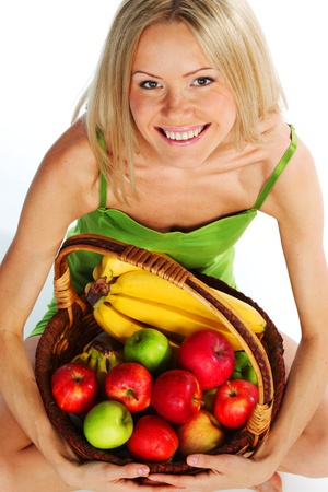 woman holds a basket of fruit on a white background Stock Photo - 10705728