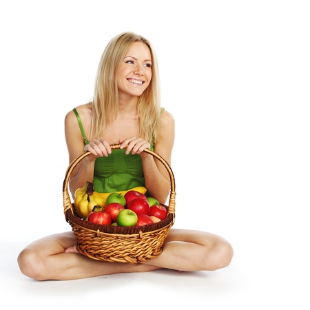 woman holds a basket of fruit on a white background Stock Photo - 10705538