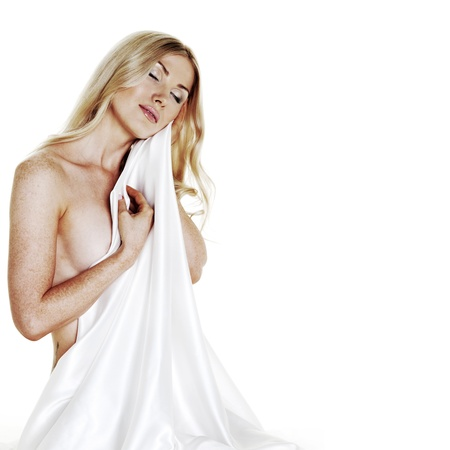 nude woman covered with white silk isolated on white Stock Photo - 10705545