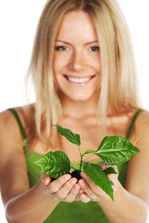 plant in blonde hands close up Stock Photo - 10705680