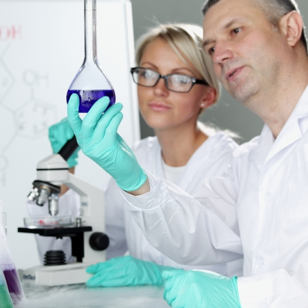 biological: two scientist in chemical lab conducting experiments Stock Photo