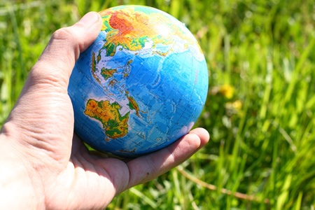 globe of planet earth in man hand Stock Photo - 10725366