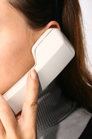 answering phone: phone ring in human hand on white