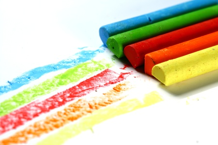 colored  paint hand art on white paper photo