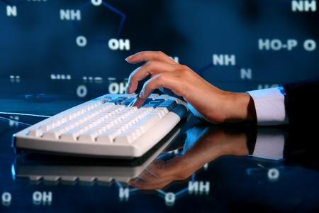 genom: dna information of genom typing on keyboard Stock Photo