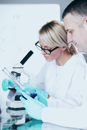 two scientist in chemical lab conducting experiments Stock Photo - 10813704
