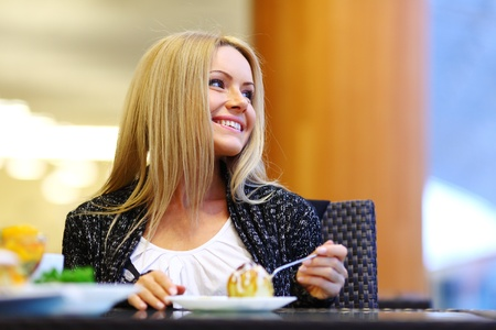 woman eat desert in caffe Stock Photo - 10813731