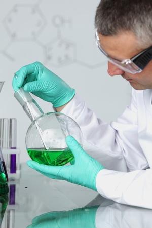 biochemist: Chemistry Scientist conducting experiments in laboratory
