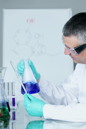 Chemistry Scientist conducting experiments in laboratory Stock Photo - 10813714
