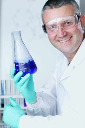 Chemistry Scientist conducting experiments in laboratory Stock Photo - 10813697