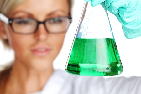 Woman  conducting a chemical experiment Stock Photo - 10813708