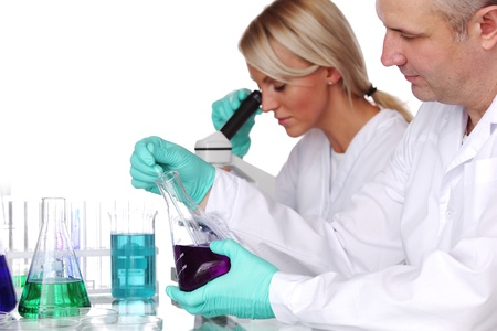 medical worker: two scientist in chemical lab conducting experiments Stock Photo