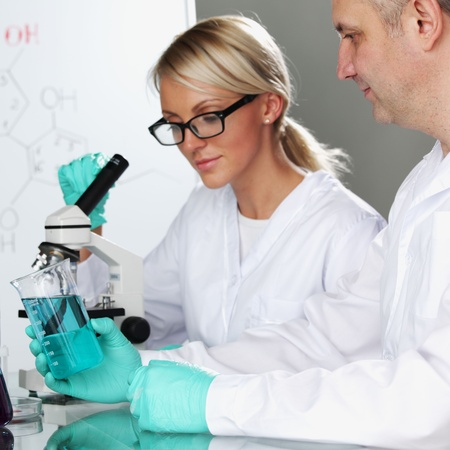 two scientist in chemical lab conducting experiments Stock Photo - 10813688
