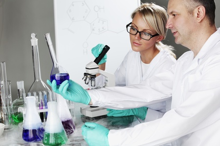 clinical research: two scientist in chemical lab conducting experiments Stock Photo