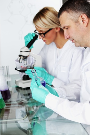 two scientist in chemical lab conducting experiments Stock Photo - 10813730