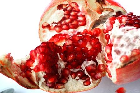 pomegranate macro close up on white background photo