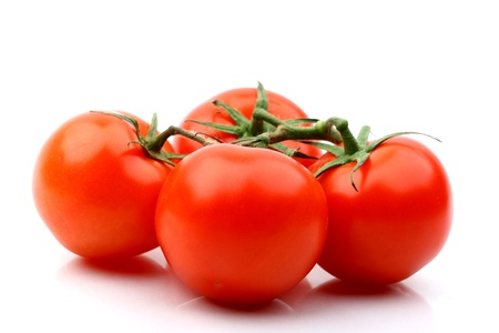 tomatos isolated on white background close up photo