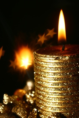 magic candle holiday background stars in dark Stock Photo - 10813843