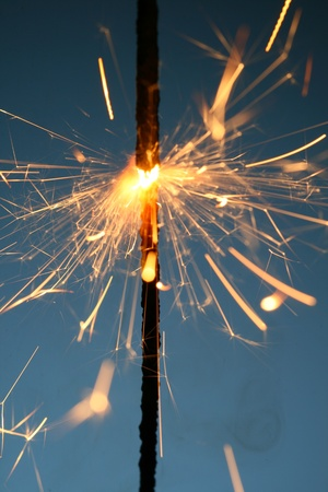 sparkler fire on blue macro background close up Stock Photo - 10858856
