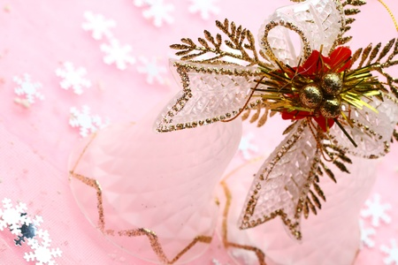 solemnity: christmas bell close up on pink background Stock Photo