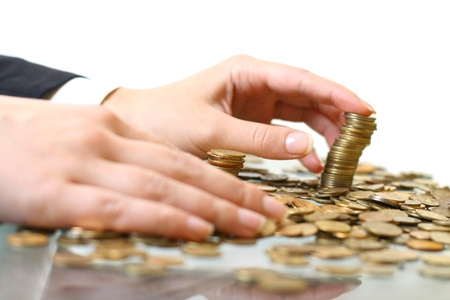 hand make coins piles on white photo