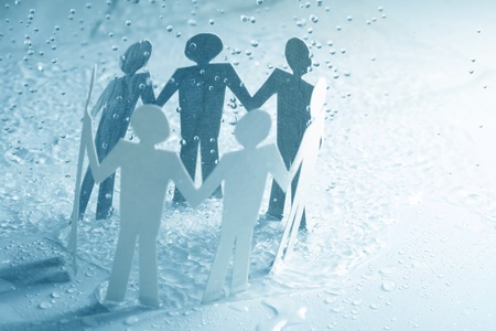 paper team linked together under rain weather concept Stock Photo - 10867383