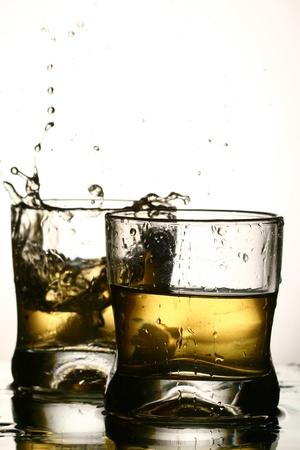 whiskey splash close up in dark photo