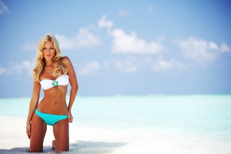 woman in bikini on sea beach photo