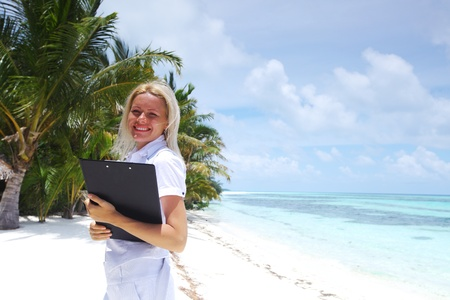 business woman on ocean coast on the background of a palm trees and sky and sea Stock Photo - 10896023