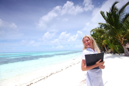business woman on ocean coast on the background of a palm trees and sky and sea Stock Photo - 10896013