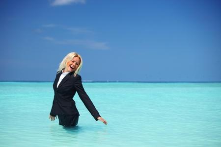 business model: business woman stay in ocean waves