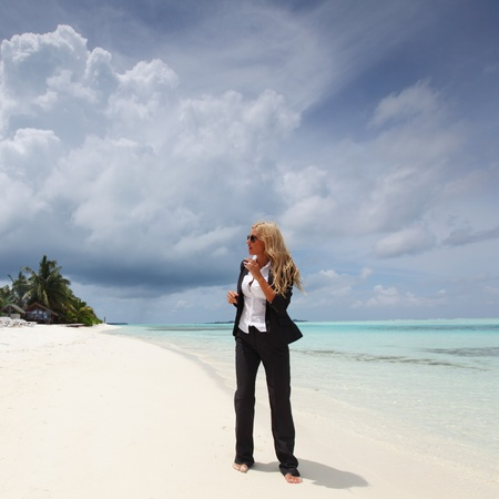 happy  business woman on the desolate ocean coast photo